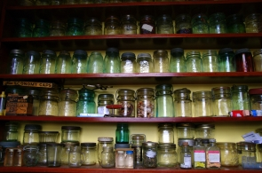 A fraction of a collection of colourful canning jars